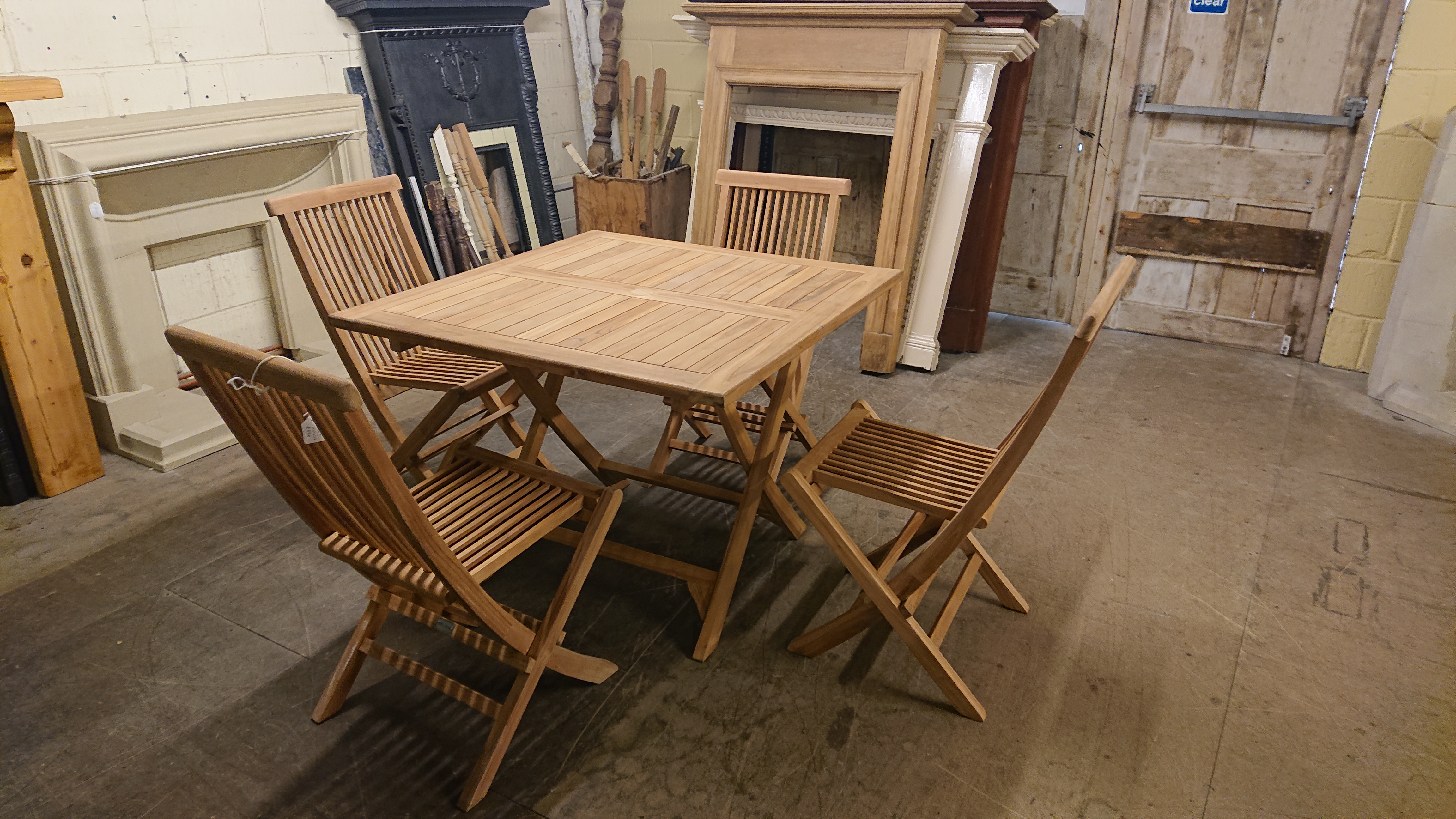 <p>Square Teak table and 4 chairs</p><p>Table and chairs fold up</p><p>Table 100 cm x 100 cm</p>