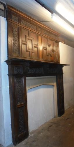Genuine and extremely rare<br>Jacobean oak chimney piece with <br>stone surround opening
