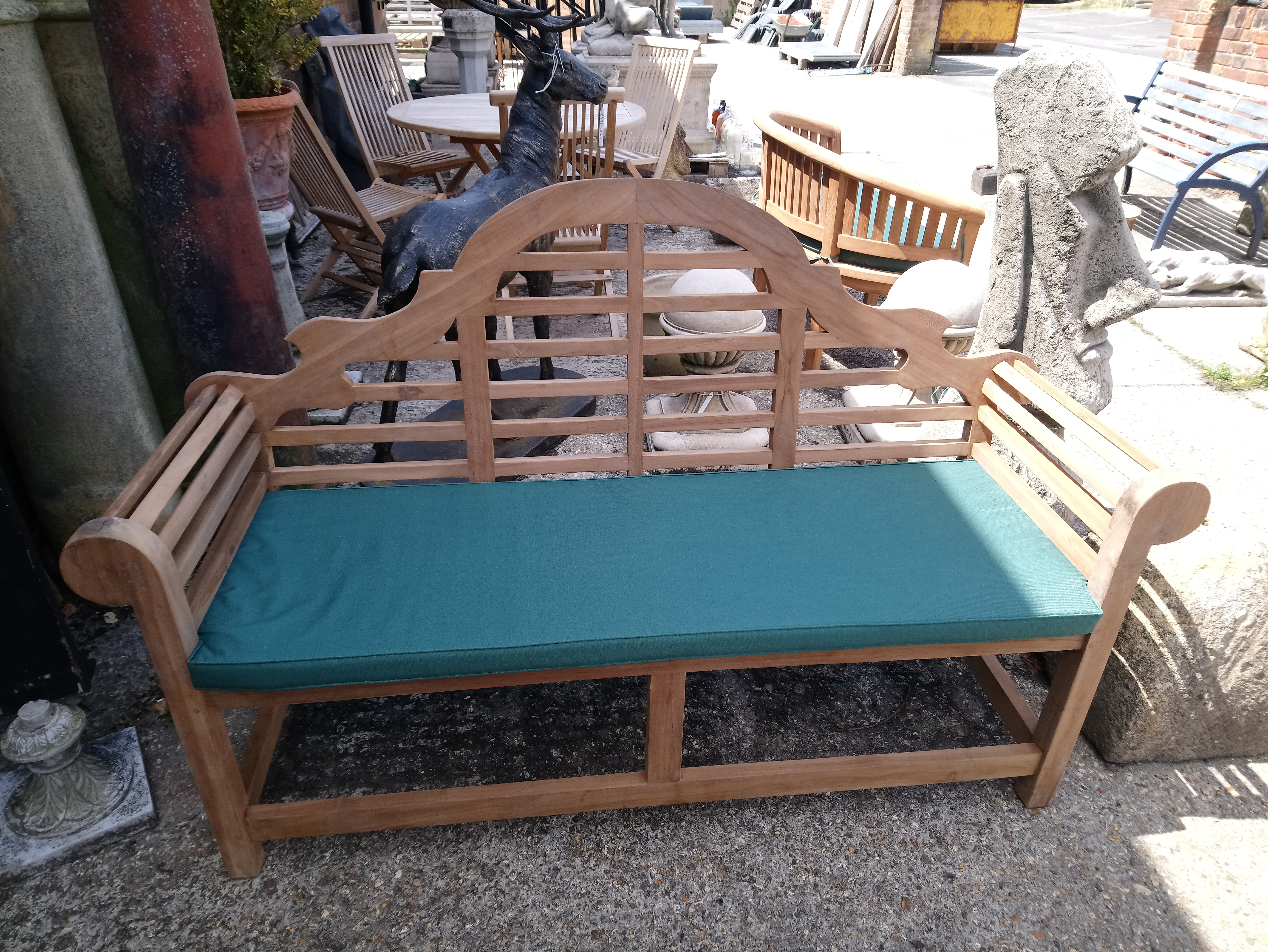 <p>Teak bench complete with cushion